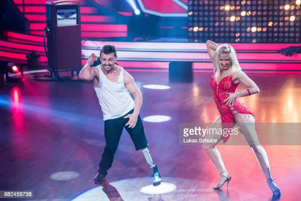 Heinrich Popow and Kathrin Menzinger perform on stage during the 8th show of the tenth season of the television competition 'Let's Dance' on May 12...