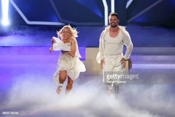 Heinrich Popow and Kathrin Menzinger perform on stage during the 9th show of the tenth season of the television competition 'Let's Dance' on May 19...