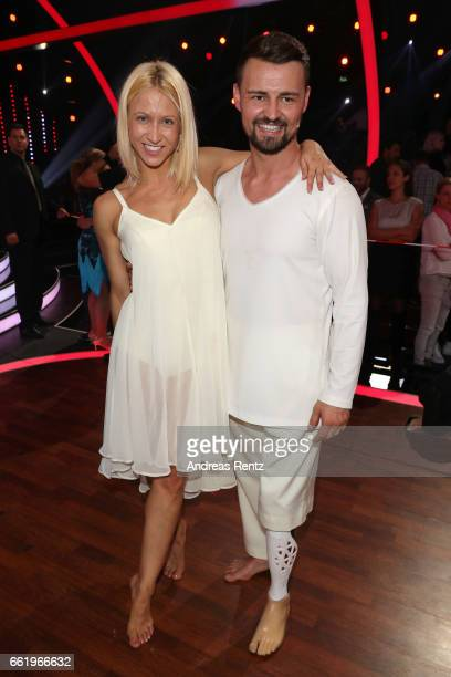 Heinrich Popow and Kathrin Menzinger pose after the 3rd show of the tenth season of the television competition 'Let's Dance' on March 31 2017 in...