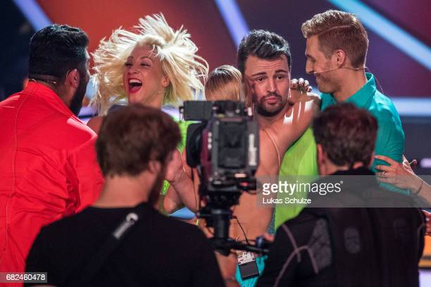 Heinrich Popow and Kathrin Menzinger react during the 8th show of the tenth season of the television competition 'Let's Dance' on May 12 2017 in...