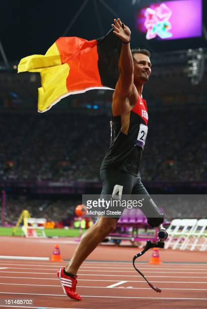 Heinrich Popow of Germany celebrates as he wins gold in the Men's 100m T42 on day 9 of the London 2012 Paralympic Games at Olympic Stadium on...