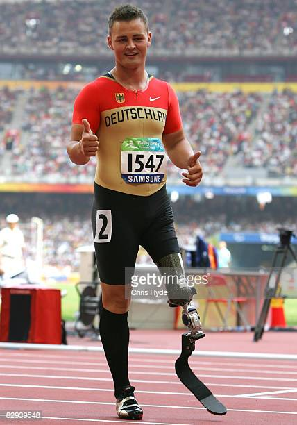 Heinrich Popow of Germany celebrates his silver medal in the Men's 100m T42 Athletics event at the National Stadium during day eight ot the 2008...