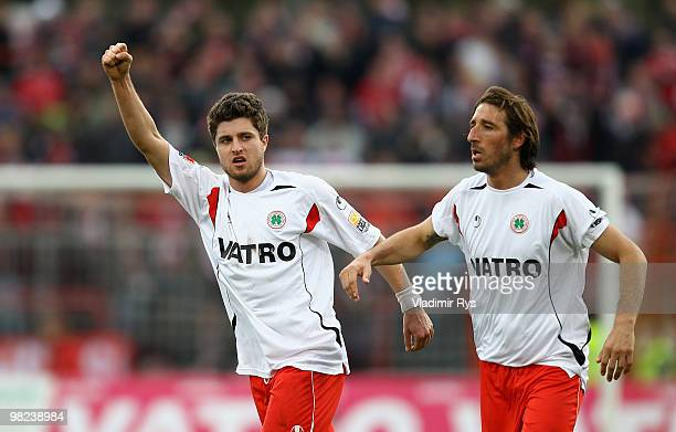 Heinrich Schmidtgal celebrates with his team mate Dimitrios Pappas of Oberhausen after scoring his team's first goal during the Second Bundesliga...