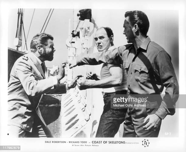 Heinz DracheActor and Richard Todd fight in a scene from the film 'Coast of Skeletons' 1964