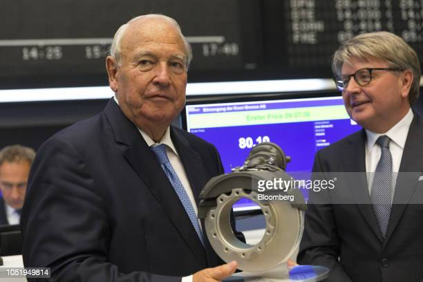 Heinz Hermann Thiele billionaire and majority owner of KnorrBremse AG holds a brake mechanism while Theodor Weimer chief executive officer of...
