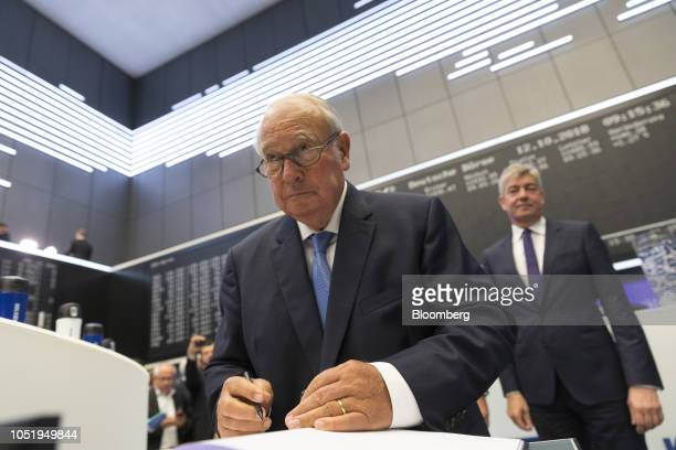 Heinz Hermann Thiele billionaire and majority owner of KnorrBremse AG signs a guest book as the company makes its initial public offering at the...
