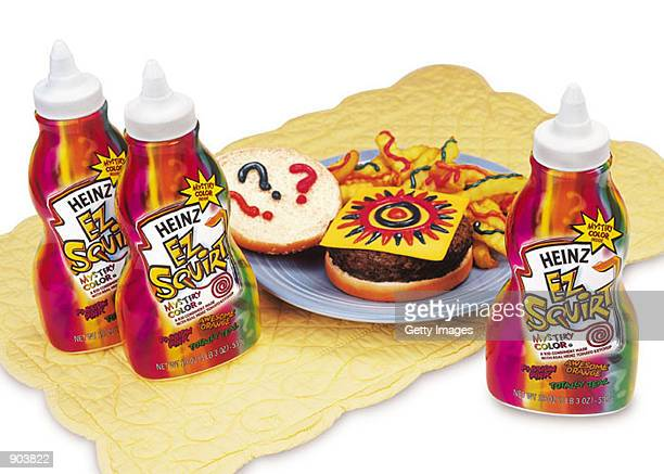 Heinz ketchup in multi colored squirt bottles are displayed February 27 2002 in this company supplied photograph Three new colors of the condiment...