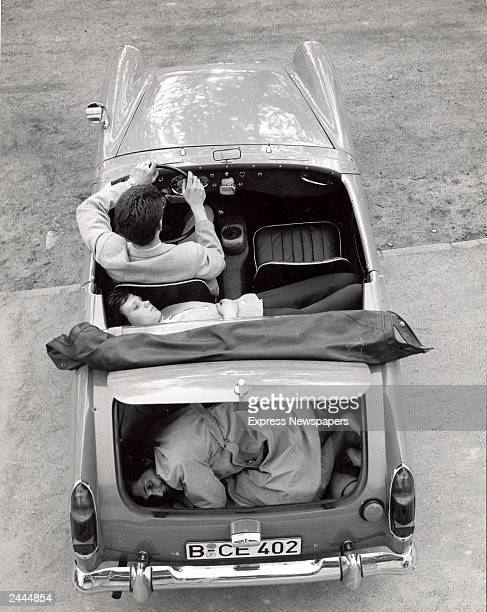 Heinz Meixner with his fiancee and her mother Frau Thurau show how they arranged themselves in his AustinHealey Sprite to drive through the Berlin...