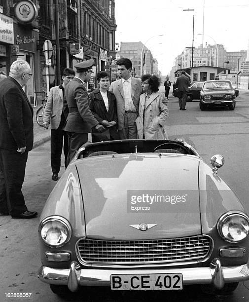Heinz Meixner with two ladies is greeted at Checkpoint Charlie by West German police circa 1961
