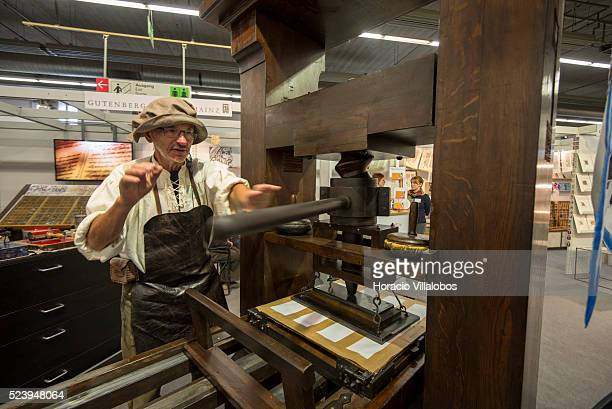 Heinz Noack operates a replica of Gutenberg printing press at the Gutenberg Museum stand in 2013 Frankfurt Book Fair in Frankfurt Germany 09 October...