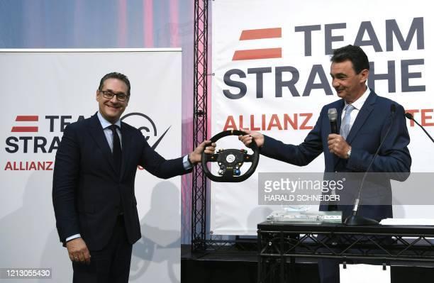 Heinz-Christian Strache , former leader of Austria's FPoe party, and Karl Baron , leader of the Allianz für Österreich citizen movement, hold a...