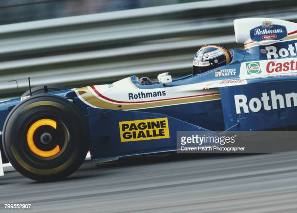Heinz-Harald Frentzen of Germany lights up the brake discs as he drives the Rothmans Williams Renault Williams FW19 Renault RS9 V10 during the...
