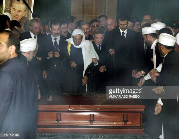 Heir apparent Bashar alAssad son of the late Syrian President Hafez alAssad drops sand onto his father's casket surrounded by Syrian VicePresident...