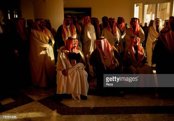 Heir Prince Abdullah bin Abdulaziz Al Saud and Prince Mishaal bin Abdulaziz Al Saud are surrounded by the kingdom's highest dignitaries on January...