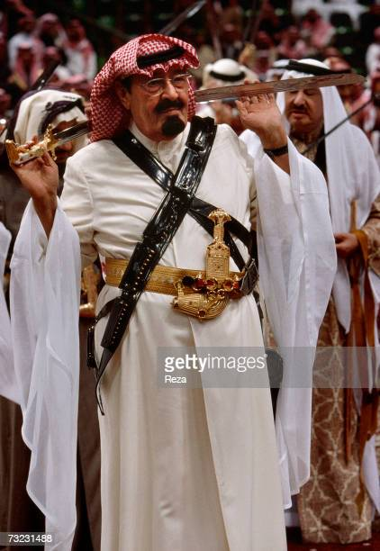 Heir Prince Abdullah bin Abdulaziz Al Saud wears traditional clothing with a sabre and the 'khanjar' a curved Arab dagger in preparation of...