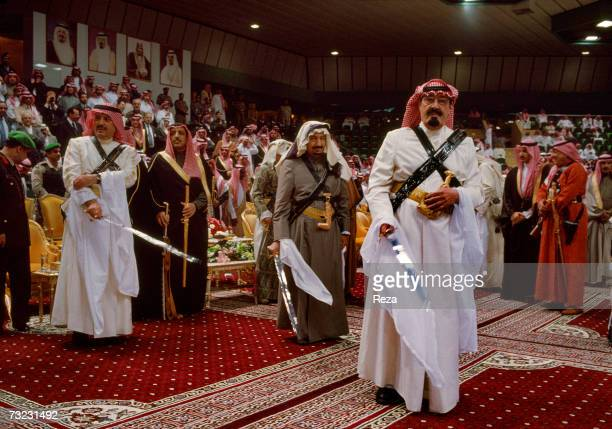 Heir Prince Abdullah bin Abdulaziz Al Saud wears traditional clothing with a sabre and the 'khanjar' a curved Arab dagger in preparation of...