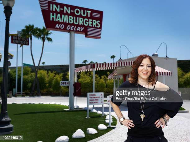 Heiress and owner of InNOut burger Lynsi Snyder is photographed for Forbes Magazine on July 30 2018 in front of a replica of the original InNOut...