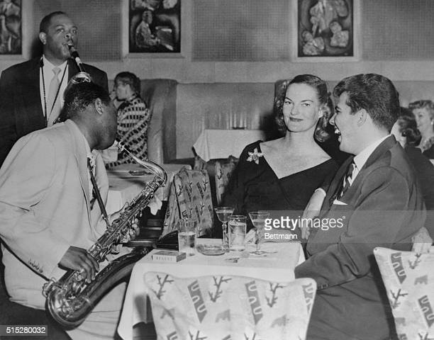 Heiress Doris Duke and companion Joe Castro are serenaded at Birdland jazz club by Big Jay McNeeley