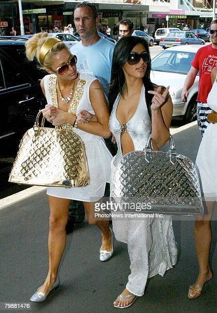 IMAGE Heiress Paris Hilton nearly causes a riot as she shops with friend Kim Kardashian in Paddington on December 31 2006 in Sydney Australia