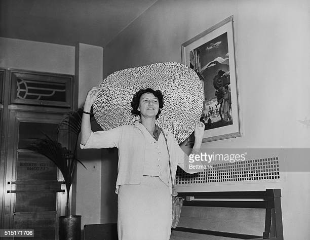 Heiress Peggy Guggenheim wears a large brimmed hat aboard the Atlantic Clipper as she arrives in New York City from France Peggy Guggenheim is the...