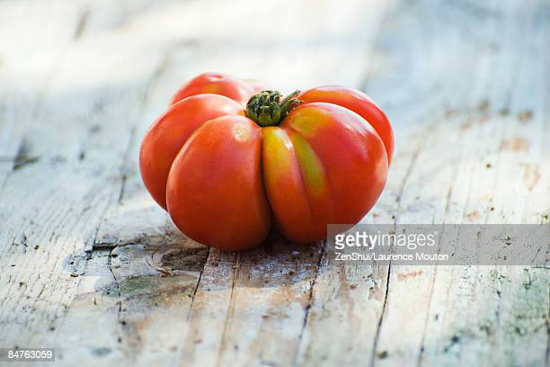 Heirloom tomato on wooden background