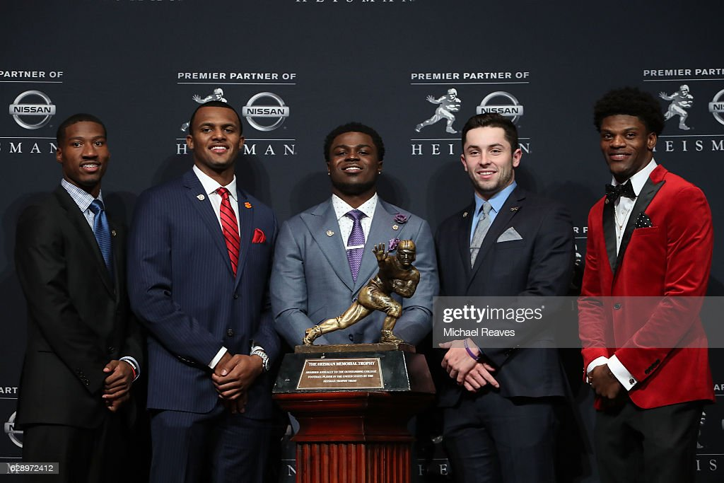 Heisman finalists Dede Westbrook of the Oklahoma Sooners, Deshaun Watson of the Clemson Tigers, Jabrill Peppers of the Michigan Wolverines, Baker Mayfield of the Oklahoma Sooners and Lamar Jackson of the Louisville Cardinals pose for a photo with the Heisman trophy during a press conference prior to the 2016 Heisman Trophy Presentation at the Marriott Marquis on December 10, 2016 in New York City.