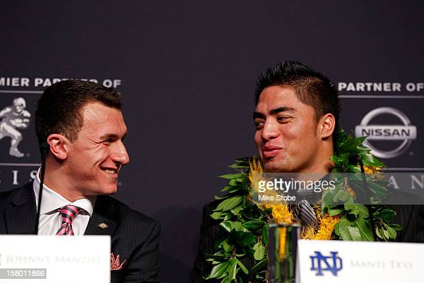 Heisman finalists quarterback Johnny Manziel of the Texas AM University Aggies talks to linebacker Manti Te'o of the University of Notre Dame...