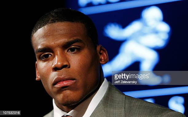 Heisman Trophy candidate Cam Newton of the Auburn University Tigers listens at a press conference at The New York Marriott Marquis on December 11...