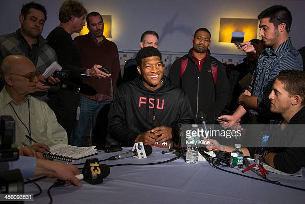 Heisman Trophy finalist Jameis Winston quarterback of the Florida State Seminoles speaks with the media at the Marriott Marquis on December 13 2013...