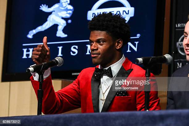Heisman Trophy finalist University of Louisville quarterback Lamar Jackson gives the thumbs up as he answers questions during the 81st Annual Heisman...