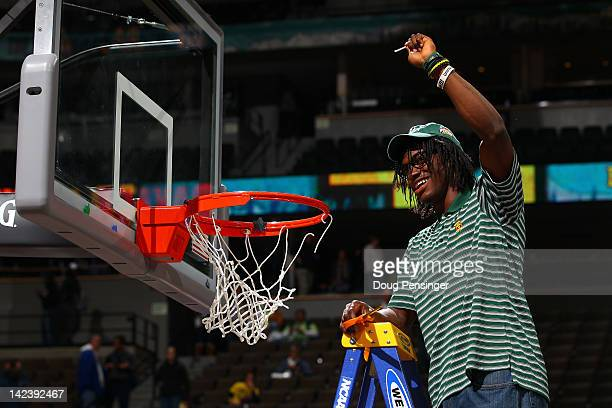 Heisman trophy winner and Baylor Bears quarterback Robert Griffin III cuts down a piece of the net in celebration of the Baylor Bears 8061 win...