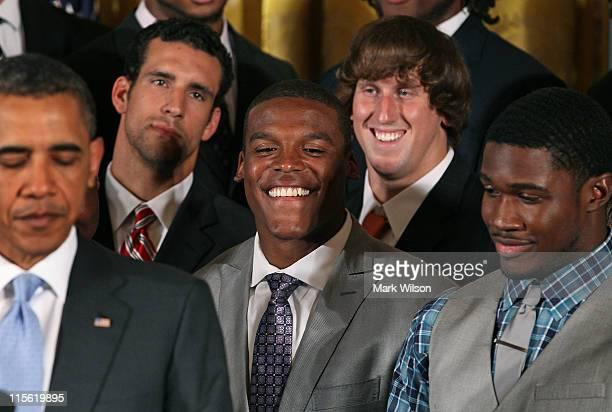 08 Heisman Trophy winner Cameron Cam Newton smiles while President Barack Obama speaks about the 2011 BCS National Champion Auburn University...