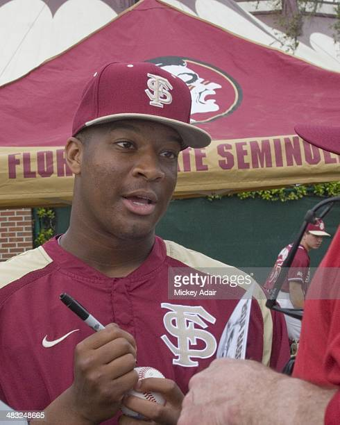 Heisman Trophy Winner Jameis Winston signs autographs prior to Florida State baseball game versus Notre Dame Winston plays outfield is a switch...
