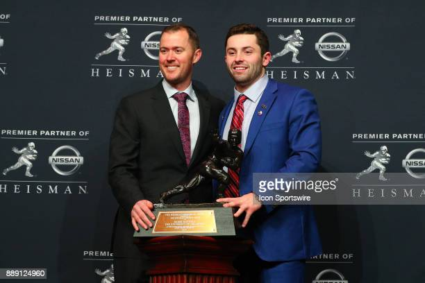 Heisman Trophy Winner University of Oklahoma quarterback Baker Mayfield and the University of Oklahoma head coach Lincoln Riley pose with the Heisman...
