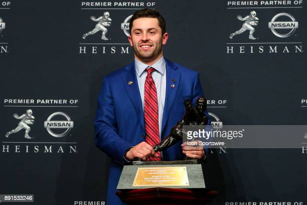 Heisman Trophy Winner University of Oklahoma quarterback Baker Mayfield poses with the Heisman Trophy during the Heisman Trophy Winner Press...