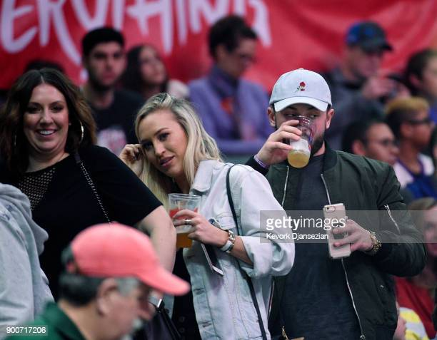 Heisman Trophy winning Oklahoma Sooners quarterback Baker Mayfield and Emily Wilkinson attend a basketball game between the Los Angeles Clippers and...