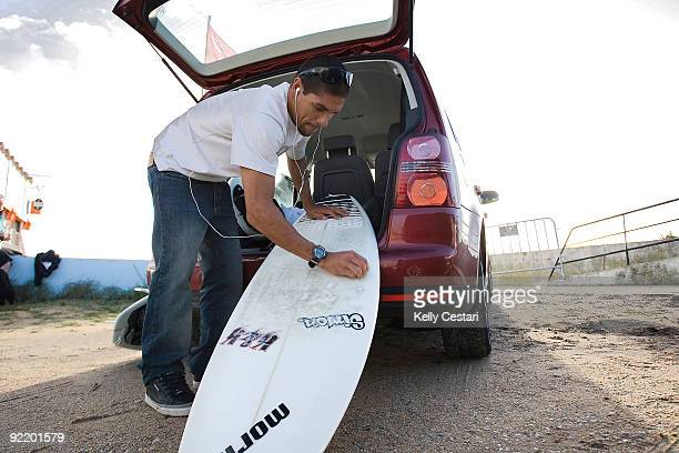 Heitor Alves of Brasil prepares the wax on his surfboard before his Round 1 heat of the Rip Curl Pro Search on October 22 2009 in Peniche Portugal