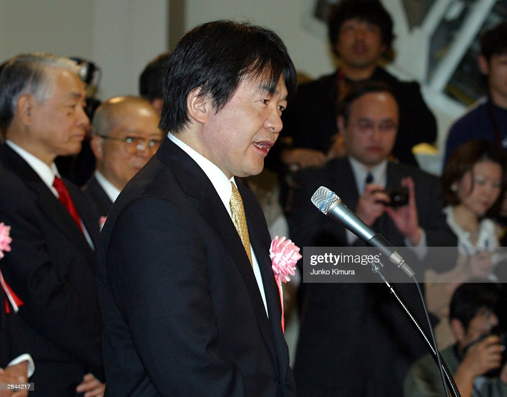 Heizo Takenaka, economic and fiscal policy minister, speaks at the opening celemony of the Tokyo Stock Exchange January 5, 2004 in Tokyo, Japan. The market reopened after closing December 30, 2003 for the new year holiday. The nikkei stock average increased by 111.19 points, or approximately 1.04 percent and marked 10,787.83 points at the start of the trading.
