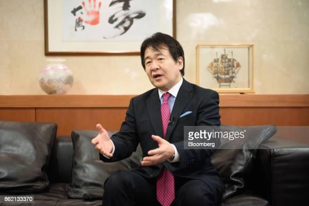 Heizo Takenaka professor at Toyo University and professor emeritus at Keio University gestures as he speaks during an interview in Tokyo Japan on...