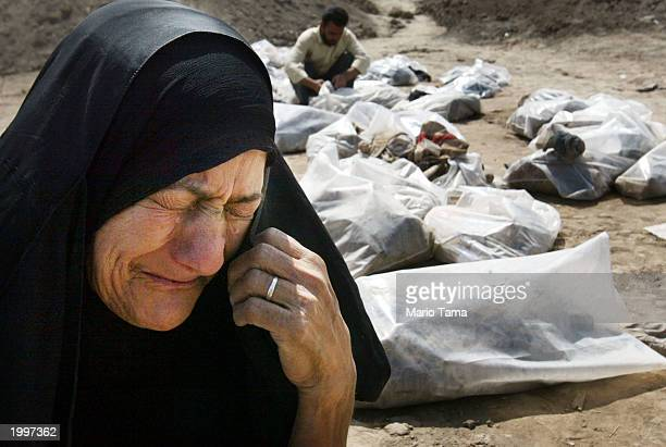 Hekeema Nagiy cries as she searches for her two missing sons at a mass grave on May 14 2003 in Hillah Iraq At least 2000 bodies have been dug out at...