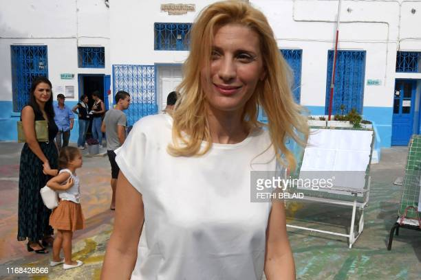 Hela the wife of the Tunisian prime minister leaves a polling station in the capital Tunis after casting her ballot during presidential elections on...