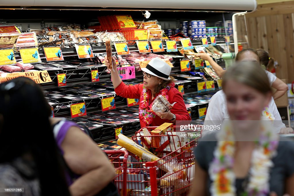 Helaine Goodner shops in the meat sectoin as she enjoys the grand opening of a Trader Joe's on October 18, 2013 in Pinecrest, Florida. Trader Joe's opened its first store in South Florida where shoppers can now take advantage of the California grocery chains low-cost wines and unique items not found in other stores. About 80 percent of what they sell is under the Trader Joe's private label.