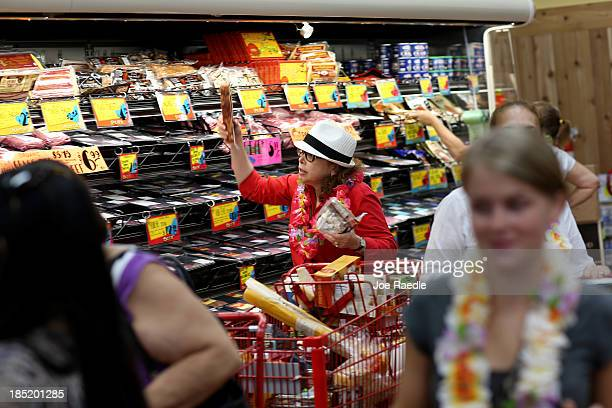 Helaine Goodner shops in the meat sectoin as she enjoys the grand opening of a Trader Joe's on October 18 2013 in Pinecrest Florida Trader Joe's...