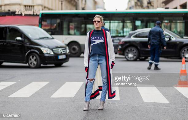 Helana Bordon wearing an oversized cardigan denim jeans outside Moncler on March 7 2017 in Paris France