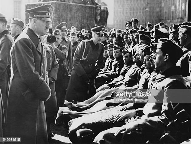 Heldengedenktag Adolf Hitler talking to wounded soldiers in front of the Neue Wache Unter den Linden in Berlin