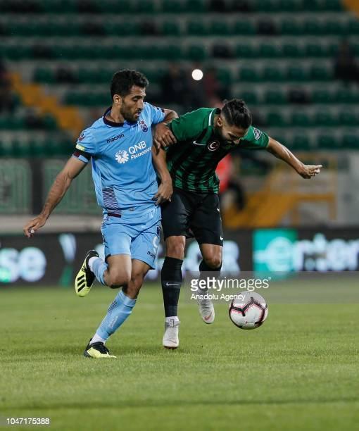 Helder Barbosa of Akhisarspor in action against Vahid Amiri of Trabzonspor during Turkish Super Lig soccer match between Akhisarspor and Trabzonspor...