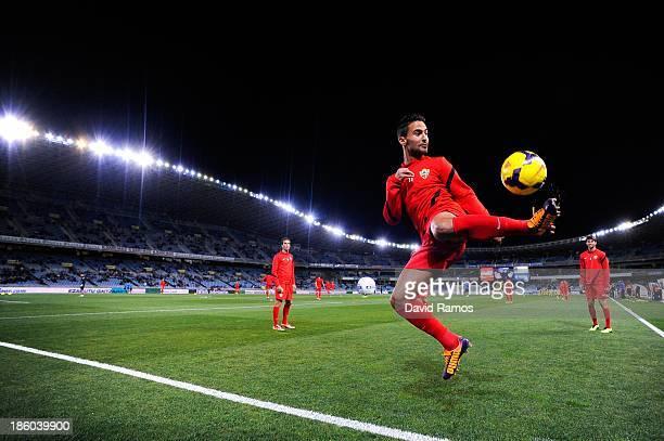 Helder Barbosa of UD Almeria juggles the ball during the warm up prior to the La Liga match between Real Sociedad de Futbol and UD Almeria at Estadio...
