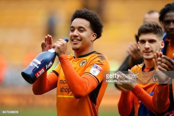 Helder Costa and Ruben Vinaigre of Wolverhampton Wanderers applaud supporters following the Sky Bet Championship match between Wolverhampton...