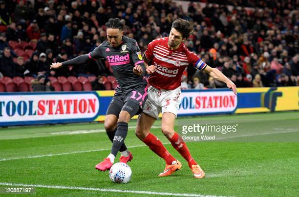 Helder Costa of Leeds United battles for possession with George Friend of Middlesborough during the Sky Bet Championship match between Middlesbrough...
