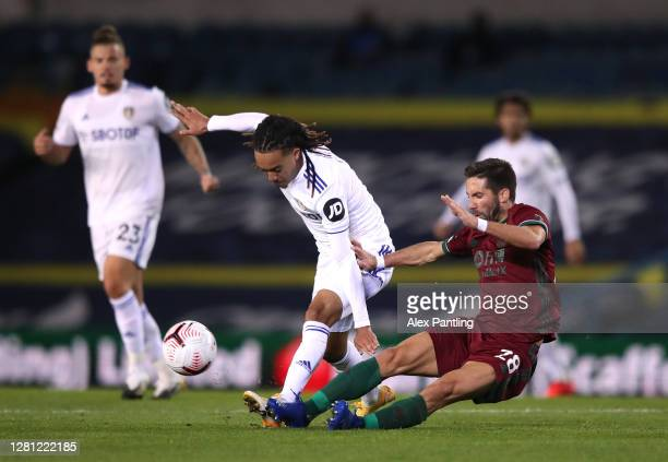 Helder Costa of Leeds United battles for possession with Joao Moutinho of Wolverhampton Wanderers during the Premier League match between Leeds...